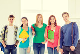 smiling students with bags and folders at school