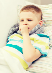 ill boy with flu at home
