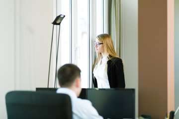 Young business people at office, business woman seeing the futur