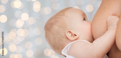 Leinwanddruck Bild close up of mother breast feeding adorable baby