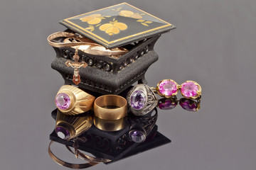 Small jewellery box with rings, chain and cross