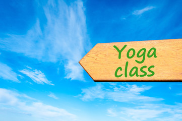 Arrow sign with Yoga Class message