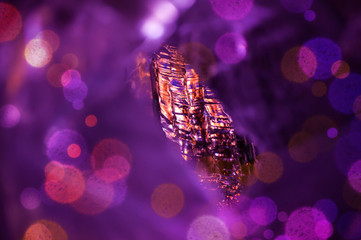 Winter abstract background with colorful ice and bokeh