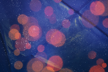 Winter abstract background with colorful bokeh