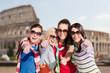 happy teenage girls or women showing thumbs up