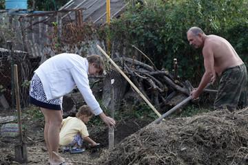Family planting seedlings
