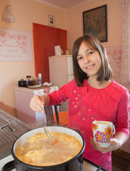 young girl  at the cooking