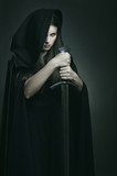 Evil expression of beautiful dark woman