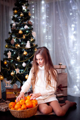 Girl with basket of tangerines