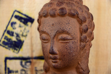 Buddha statue with old wooden crate background