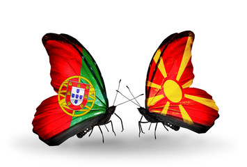 Two butterflies with flags Portugal and Macedonia
