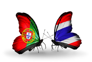 Two butterflies with flags Portugal and Thailand