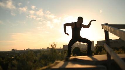 Man dancing at sunset