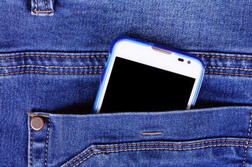 Part of cellphone in blue jeans pocket