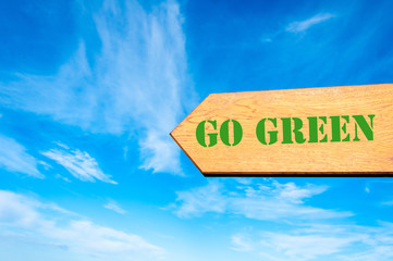 Arrow sign with Go Green message