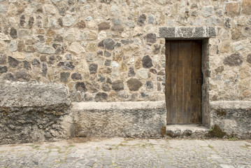 Spanish Colonial Style - Wooden Door And Stone Wall