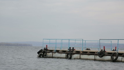 Sad pensive man walks on the pier and walks to the edge