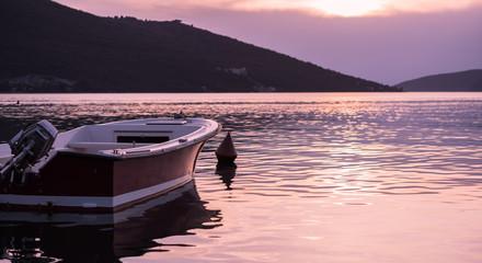 Motor boat on sunset