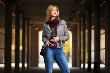 Young fashion blond woman walking in the mall