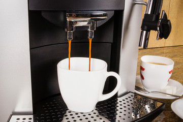 Cup of coffee in a coffee machine