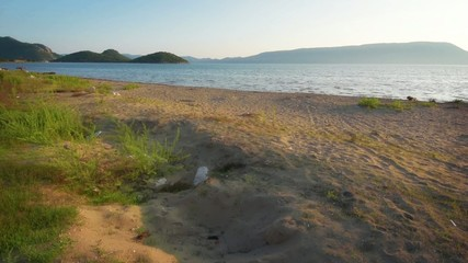 Sunset on sand beach in southern Croatia with Adriatic sea