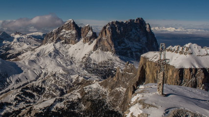 Cross on edge of precipice, Sella Ronda and Sasso Lungo peaks,