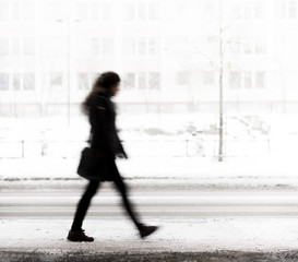 Young woman walking in winter