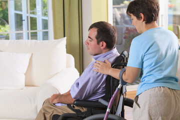 Wife touching the shoulder of husband both with Cerebral Palsy