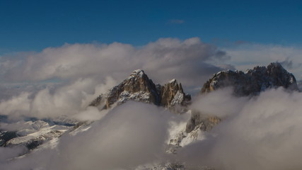 Sasso Lungo peak covered in clouds winter Dolomite alps