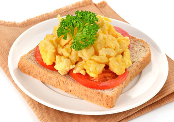 scrambled eggs with parsley,tomato and bread