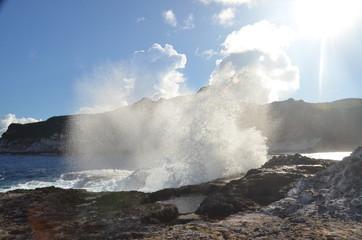 Wave crashing on stones