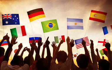 Group of People Waving National Flags in Back Lit Concept