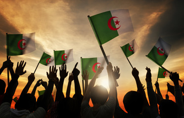 Silhouettes People Holding Flag Algeria Concept
