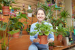 Happy mature woman  in flower store