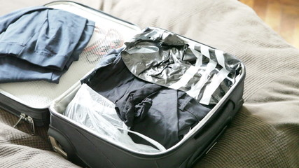 man thrown clothes and toothbrush in  suitcase and pulled out of