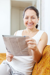 wonder  mature woman with newspaper
