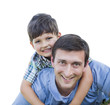 Happy Father and Son Piggyback Isolated on White