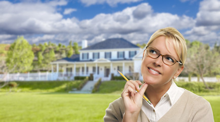 Young Woman With Pencil in Front of House