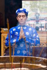 Praying with closed eyes