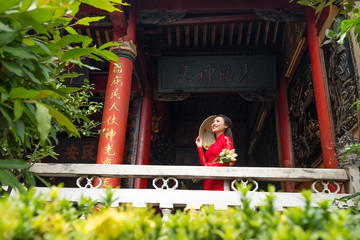 Beautiful Vietnamese woman in front of Buddhist temple