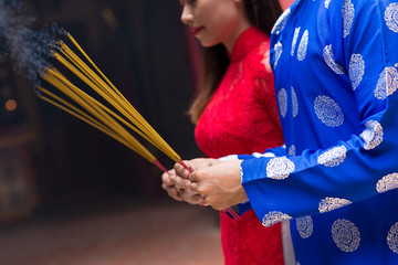 Hands with incense sticks