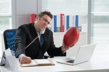 Businessman with a football