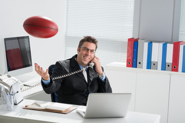 Manager with a rugby ball