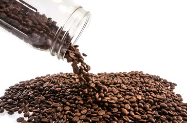 coffee beans spilling out glass bottle