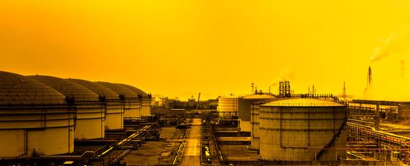 refinery with smoke stacks