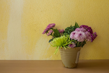 Still life with flower on wooden table and grunge background