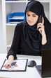 Arabic woman talking on phone