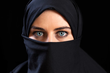 Muslim woman wearing the face veil