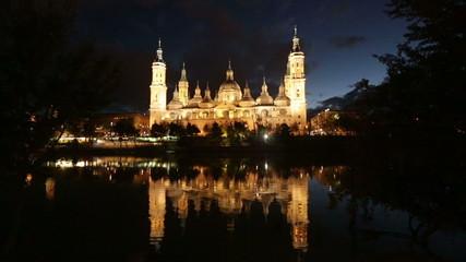 Cathedral in Zaragoza from Ebro river in   night. Aragon, Spain