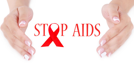 Woman with aids awareness red ribbon in hands